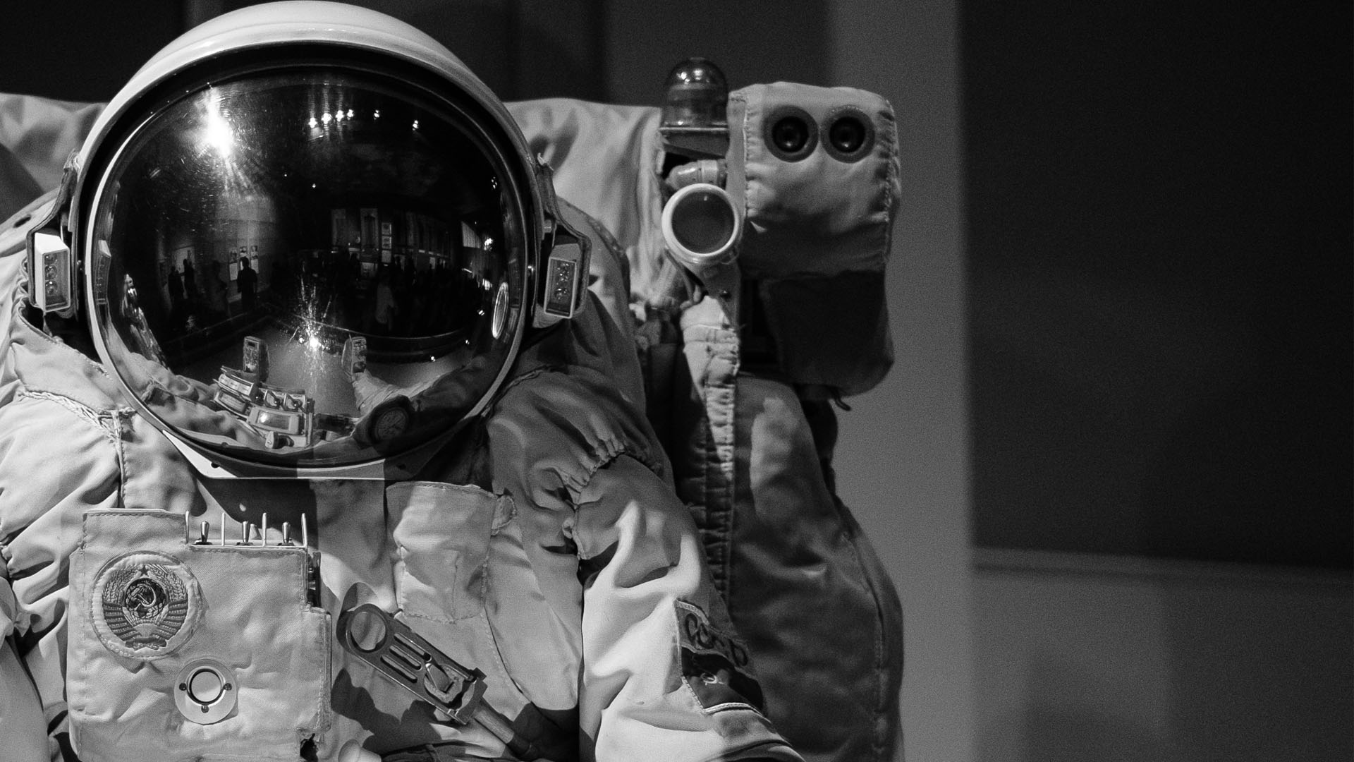 Black and white image of space suit.