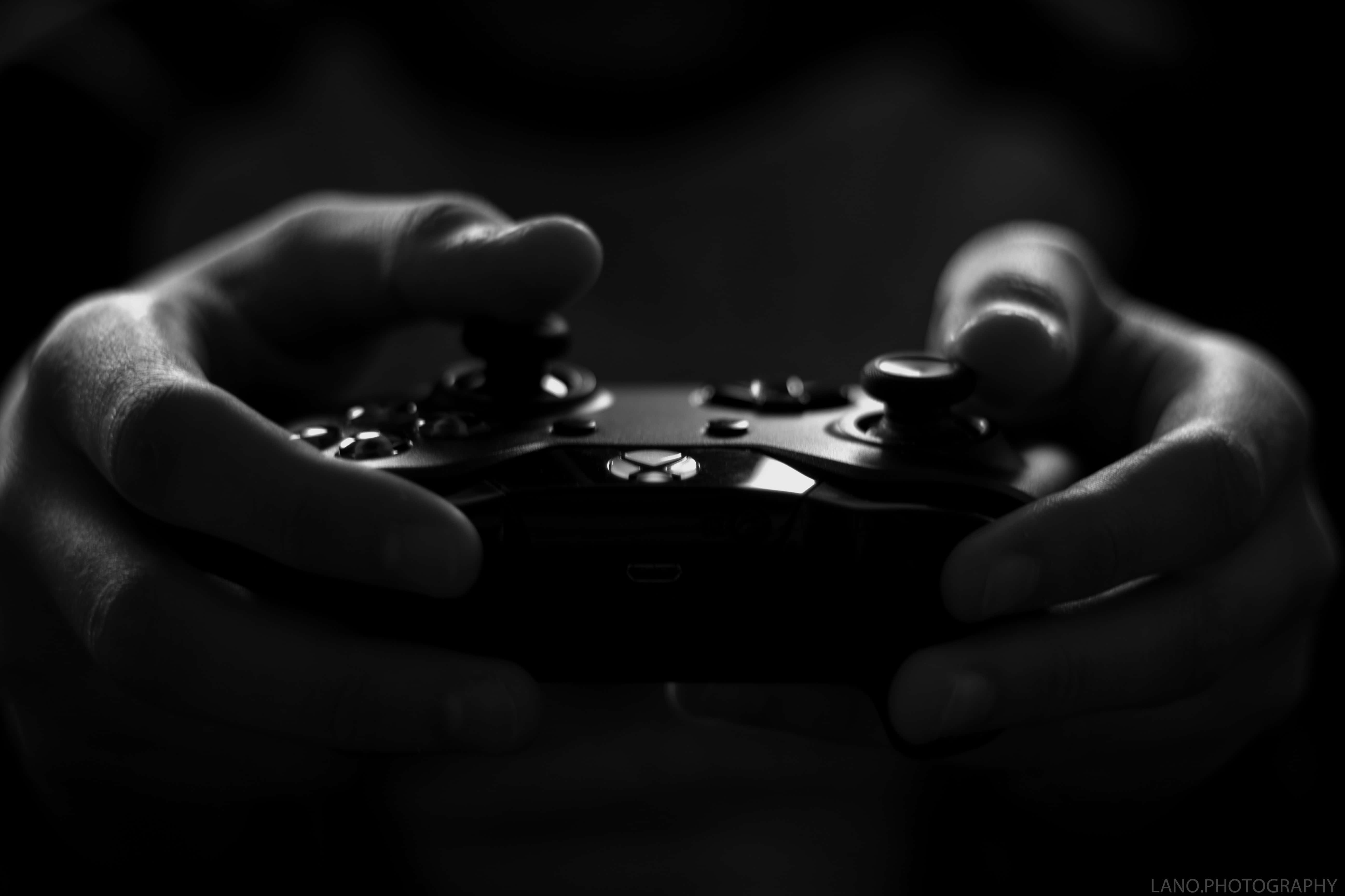 person holding a controller.